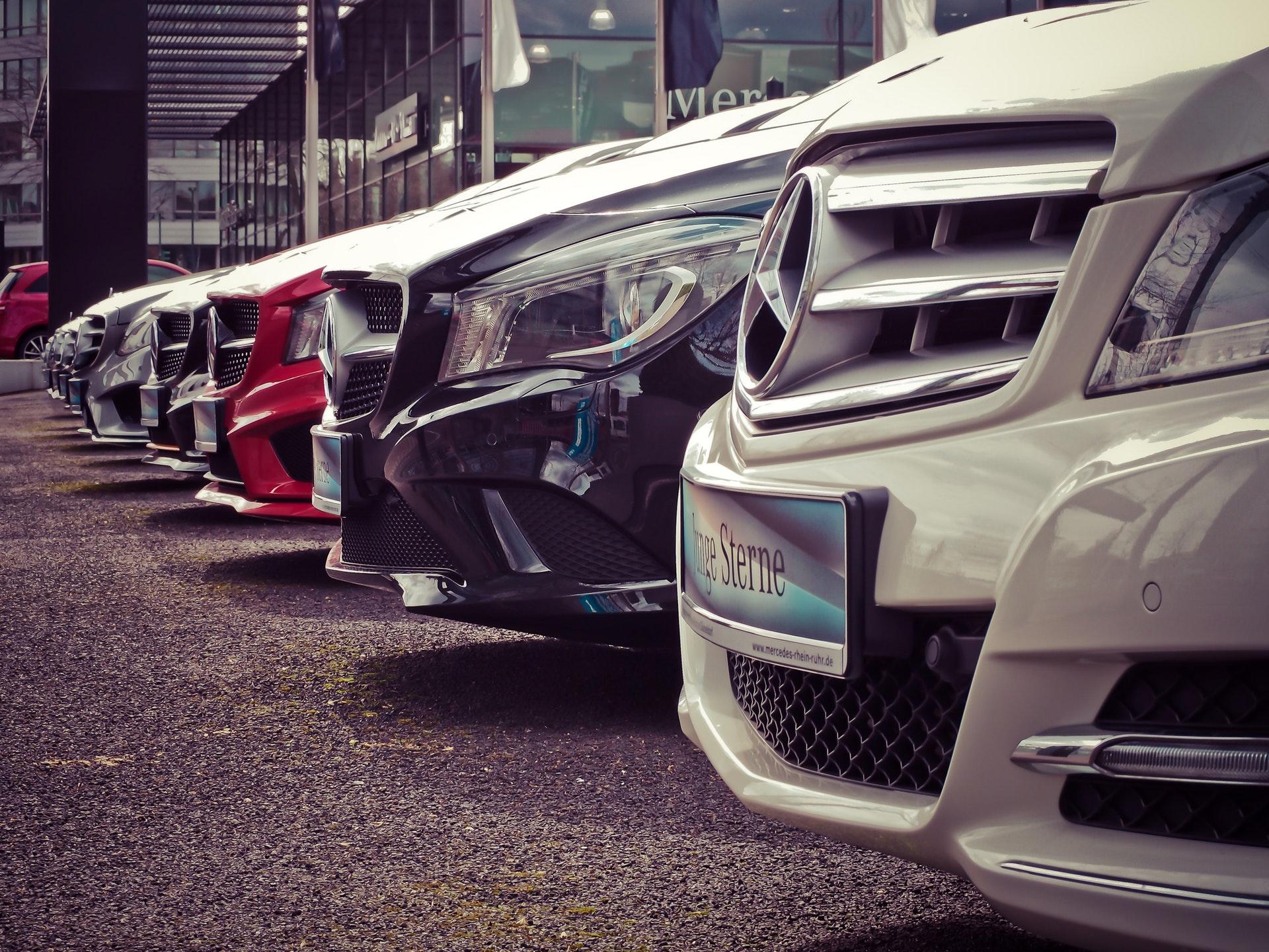 Line of new mercedes benz cars at car dealership