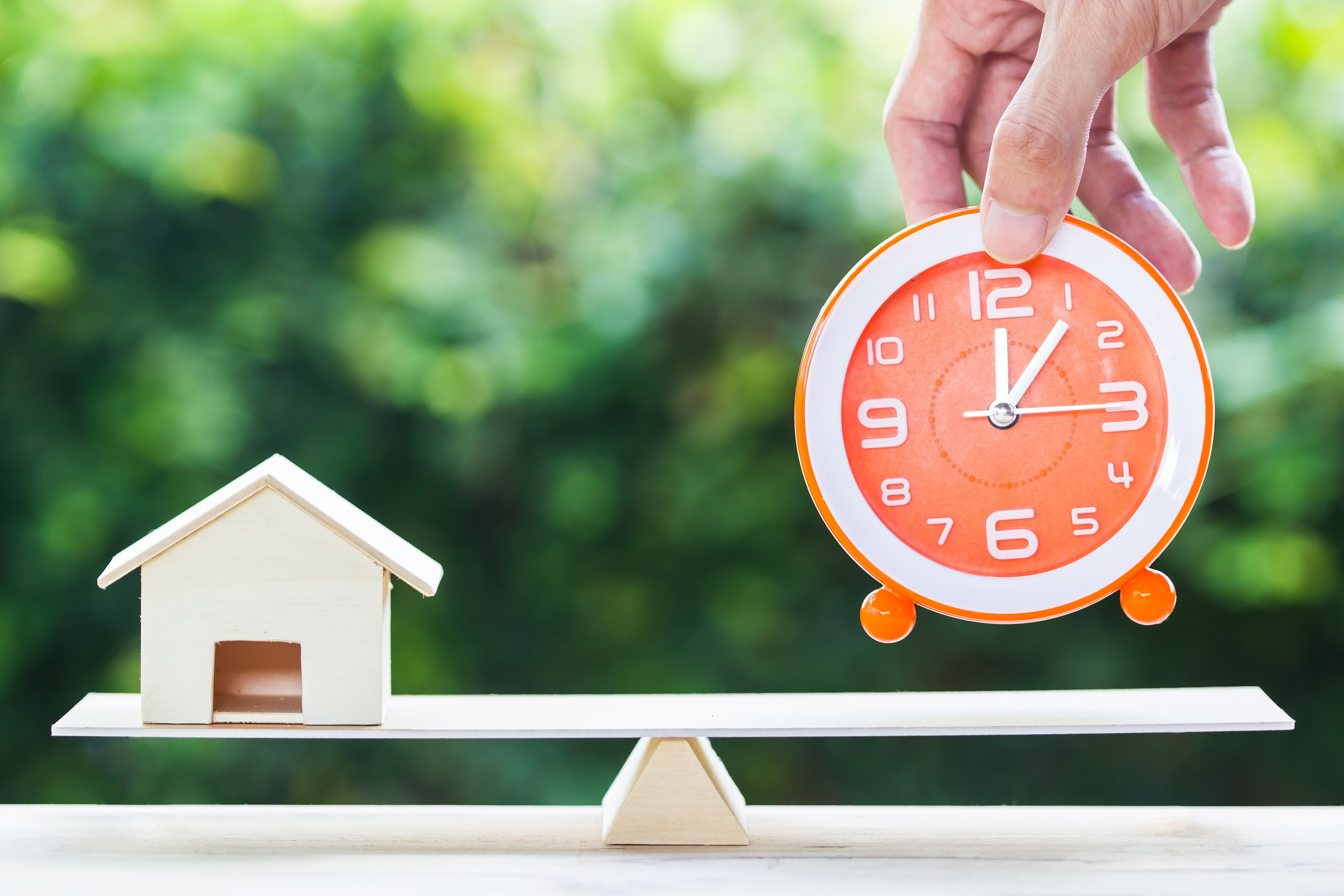 Potential home buyer putting down clock