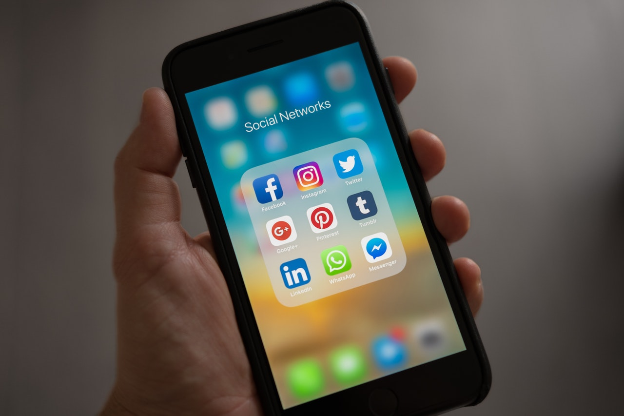 real estate agent opening social media apps