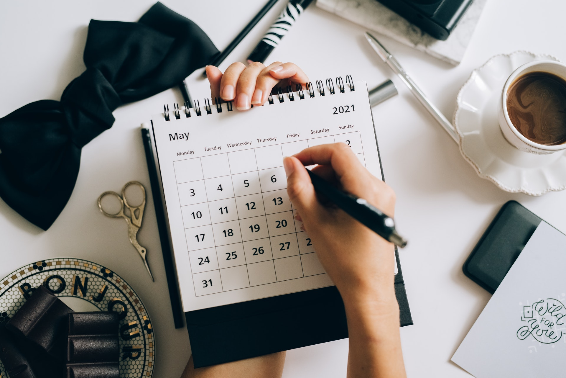 Real estate agent planning first month on a calendar