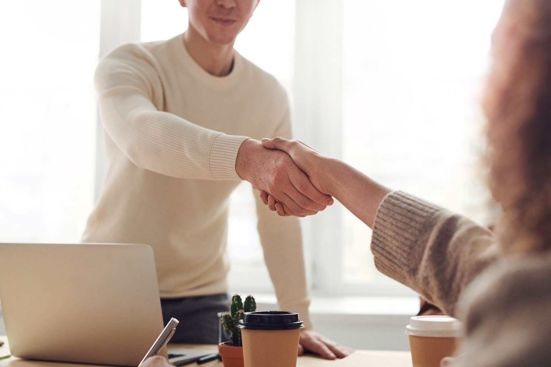 Realtor shaking hands with a client
