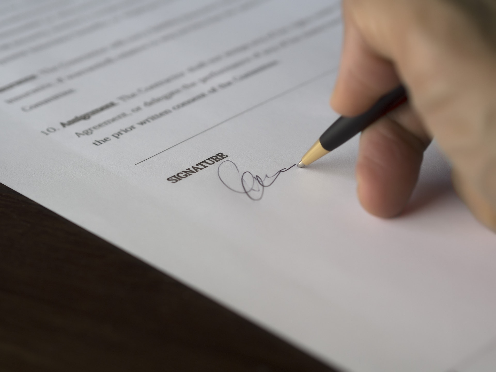 Signing car insurance agreement for added broker coverage